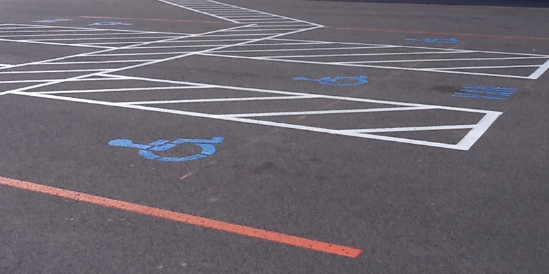All blue ada handicap parking lot markings