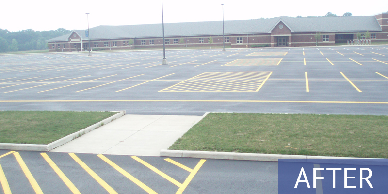 school with new parking lot markings - after shot