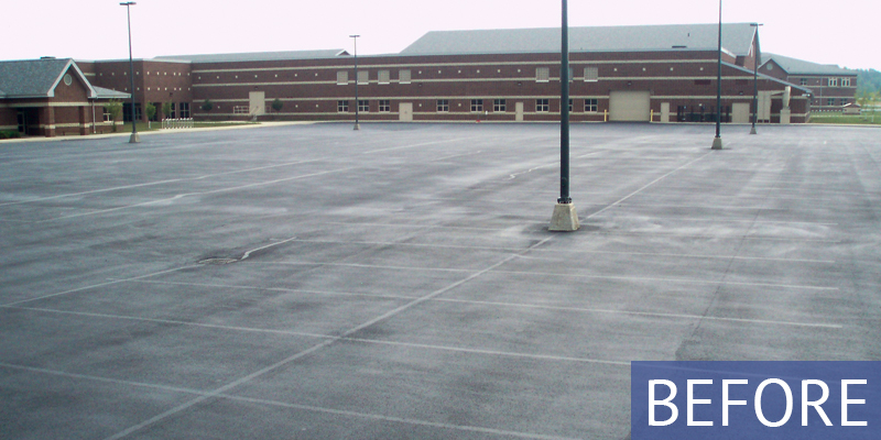 another angle of a school with no parking lot lines - before shot