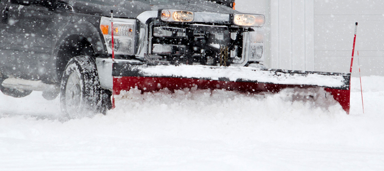 Close up of a truck plowing snow