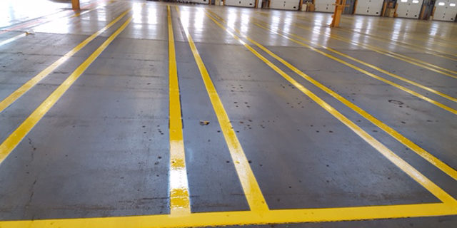 wide shot of warehouse markings - long yellow lines