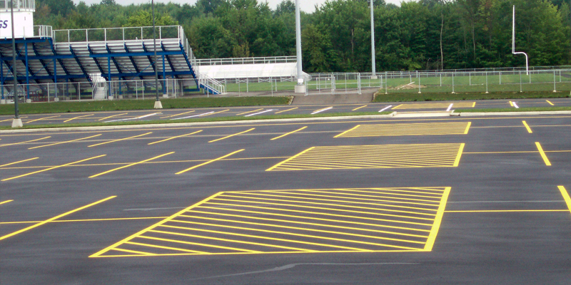 new construction of a school parking lot markings at the football field parking
