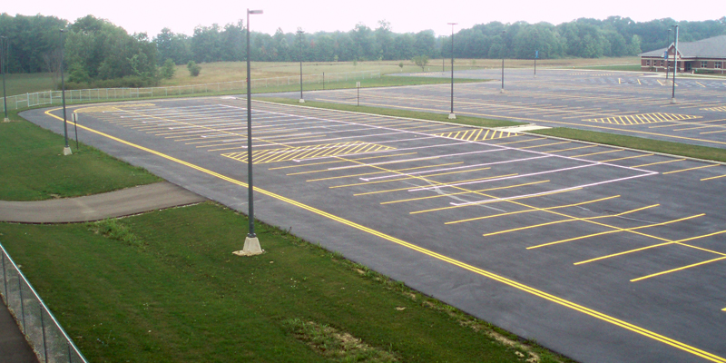 angle shot of parking lot lines at a school