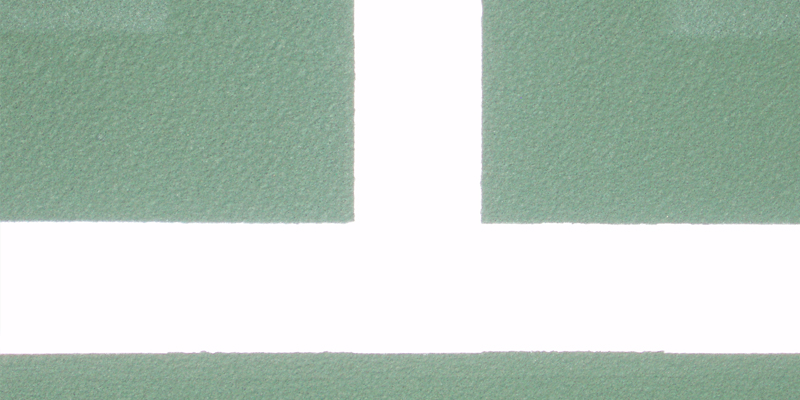 extreme close up of a tennis court marking baseline and side line that forms a T