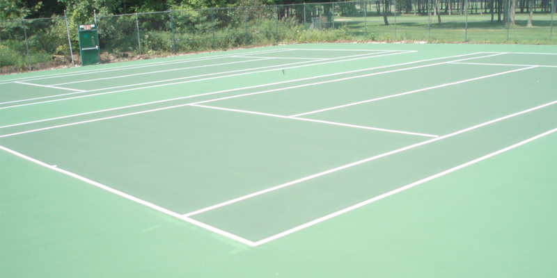 two tennis courts with new markings (green and white lines)