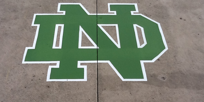 close up of a Notre Dame logo - green with white outlines