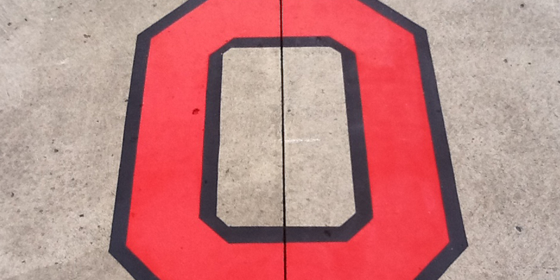 """close up of Ohio State """"O"""" - red with black outlines"""